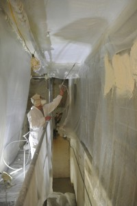 18 mils of fire barrier coating sprayed over the spray foam gives the building a 15 minute fire barrier.