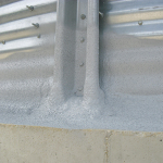 4. If needed, a second coat of elastomeric coating is applied. Granuals are embedded to deter birds and insects.